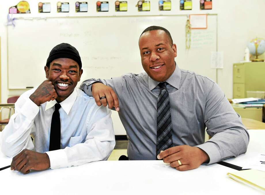 (Peter Hvizdak - New Haven Register)  New Light High School student DeJuan Ward, left, received the I Rise award from the New Haven School District, and New Light High School student counselor Ray Coplin recently received a Connecticut College Summit awards recently. Photo: ©2015 Peter Hvizdak / ©2015 Peter Hvizdak