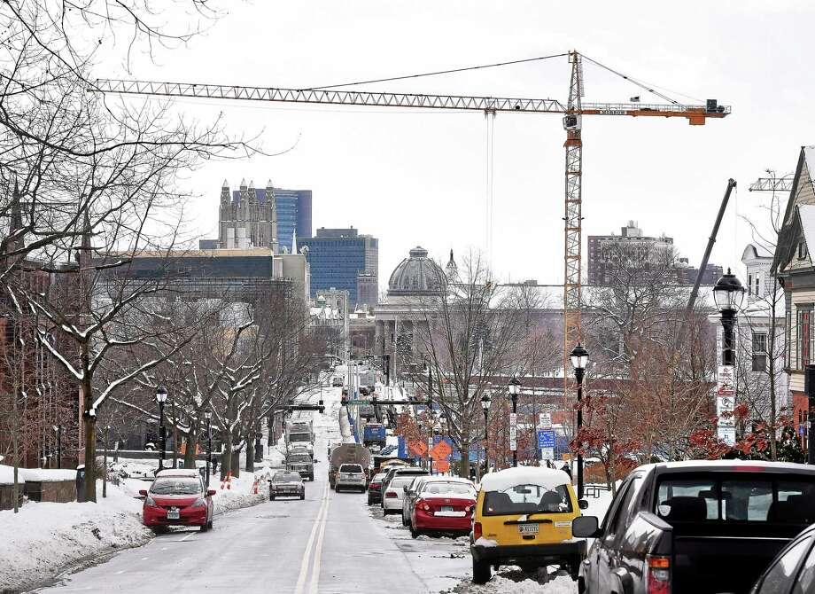 (Arnold Gold-New Haven Register)  A crane at a construction site for two residential colleges for Yale University crosses Prospect St. in New Haven on 3/2/2015. Photo: Journal Register Co.