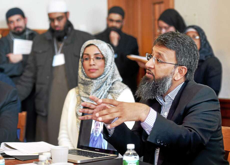 (Arnold Gold-New Haven Register)  Altaf Husain (right), Vice President of the Islamic Society of North America, speaks about The Bilal Initiative: Understanding and Dealing with Prejudice in the Muslim American Community during the 5th Annual National Shura and In-service Training for Chaplains and Imams and Other Service Providers to the Muslim Community at Yale University in New Haven on 3/7/2015 Photo: Journal Register Co.