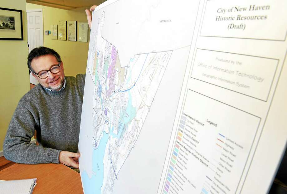 (Peter Hvizdak - New Haven Register)  John Herzon, Preservation Services Officer with the New Haven Preservation Trust, with a draft of a map of the City of New Haven Historic Resources, in his State Street office, March 4, 2015. Photo: ©2015 Peter Hvizdak / ?2015 Peter Hvizdak