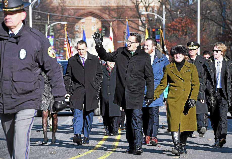(Arnold Gold-New Haven Register)  Governor Dannel P. Malloy waves as he walks up Trinity St. with his wife, Catherine, during the Inaugural Parade in Hartford on 1/7/2015. Photo: Journal Register Co.