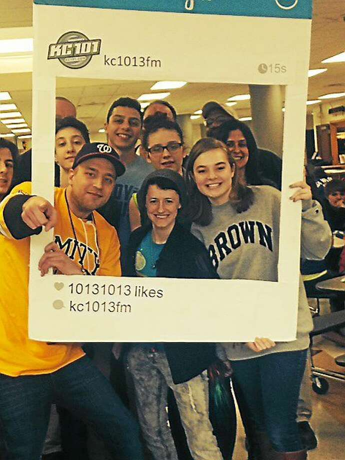 KC101 disc Jockey Adam Rivers hams it up with Amity students during lunchtime at the kick-off of a statewide Prom Promise campaign. Photo: Contributed Photo