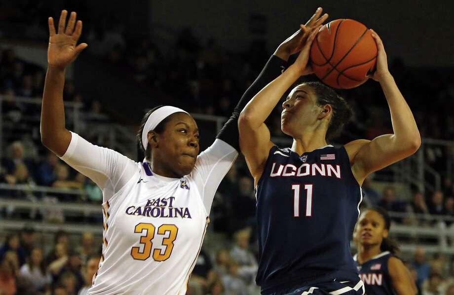 East Carolina's Janesha Ebron (33) tries to block a  shot by UConn's Kia Nurse (11). Photo: Karl B. DeBlaker — The Associated Press   / FR7226 AP