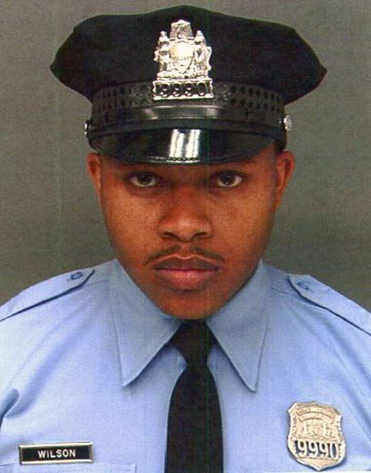 This undated photo provided by Philadelphia Police Department, shows Robert Wilson III. Wilson, a Philadelphia police officer, was shot in the head and killed after he and his partner exchanged gunfire with two suspects trying to rob a video game store, city officials said Thursday, March 5, 2015. (AP Photo/Philadelphia Police Department) Photo: AP / Philadelphia Police Department