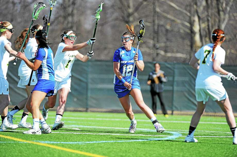 Kathryn Campbell and New Haven will take on Le Moyne Saturday morning in the first round of the NCAA Division II women's lacrosse tournament. Photo: Photo Courtesy Of UNH Athletics   / COPYRIGHT GREG WALL 2011