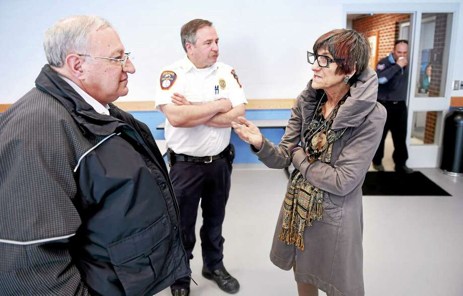(Arnold Gold-New Haven Register)  Left to right, Peter Massaro, Chief of the City of West Haven Fire Dept., Allingtown, and Guilford Assistant Fire Chief Wayne Vetre talk with Congresswoman Rosa DeLauro about the Department of Homeland Security funding vote at the Guilford Fire Dept. on 3/6/2015. Photo: Journal Register Co.