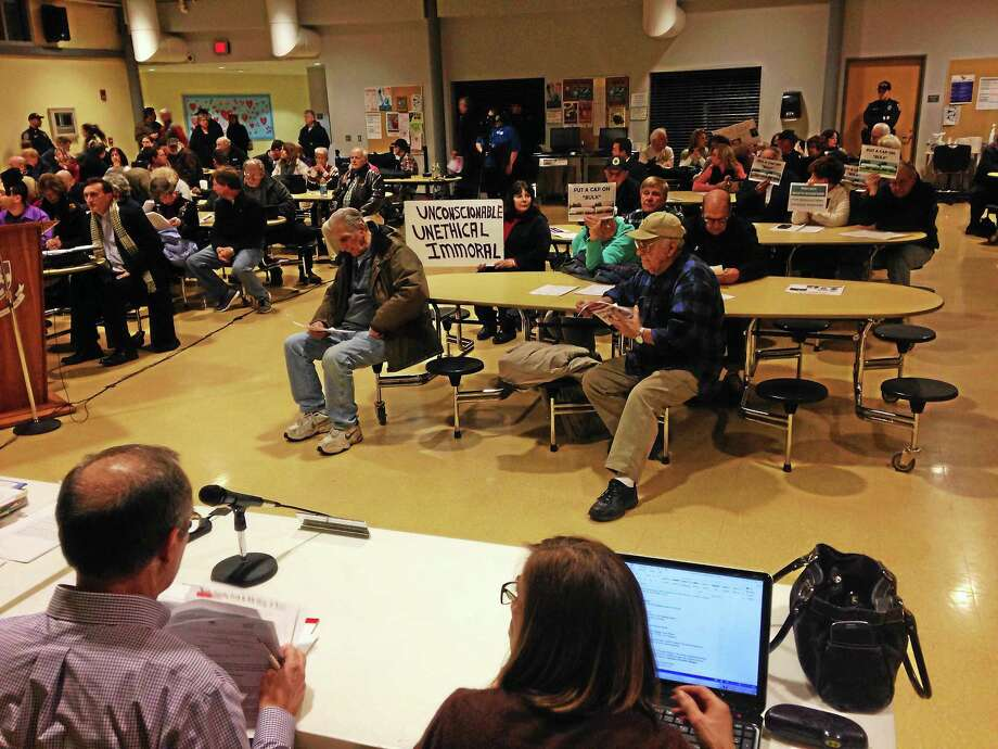 (Photo by Peter Hvizdak - New Haven Register) ¬ Residents protest  during the development of  proposed J.J. Sullivan bulk propane storage tanks in North Branford during a Town Council meeting at the North Branford Intermediate School Tuesday evening, October 7, 2014. ¬ Photo: Journal Register Co.