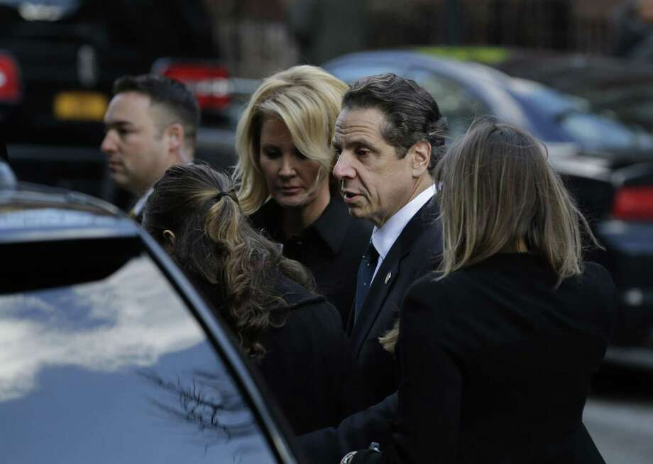 New York Governor Andrew Cuomo arrive with his girlfriend, Sandra Lee, third from left, and his daughters to the wake of his father, former New York Gov. Mario Cuomo, Monday, Jan. 5, 2015, in New York. Cuomo, 82, died in his Manhattan home on Thursday, Jan. 1. (AP Photo/Seth Wenig) Photo: AP / AP