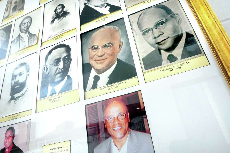 Past pastors of the Dixwell Avenue Congregational United Church of Christ in New Haven are displayed in the lobby on 2/12/2014. Photo: (Arnold Gold/New Haven Register)