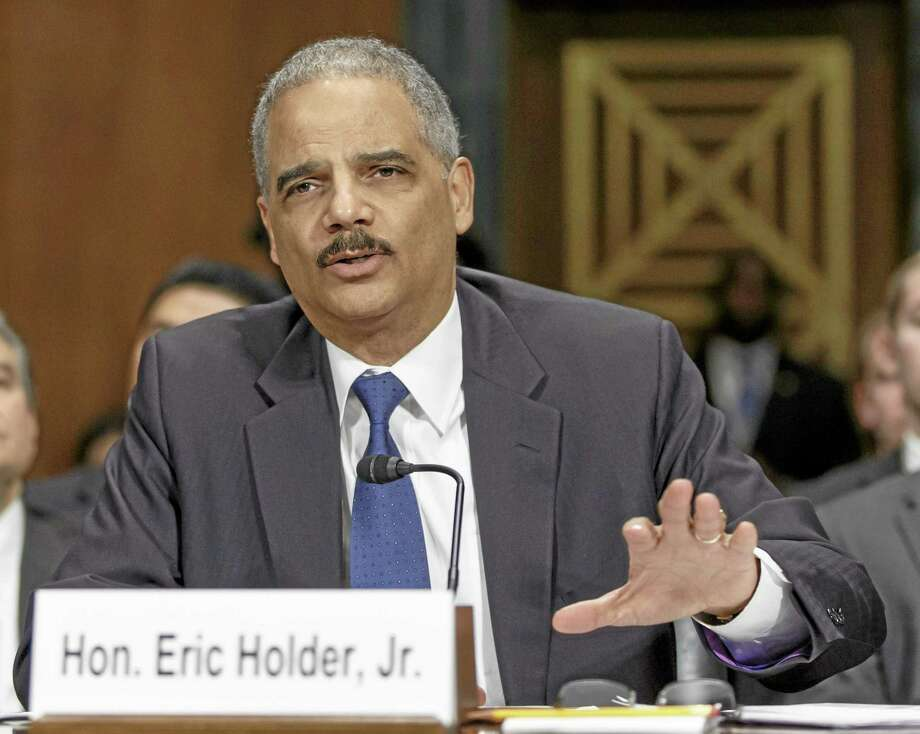 In this Jan. 29, 2014, file photo, Attorney General Eric Holder testifies on Capitol Hill in Washington. Holder called on a group of states to restore voting rights to ex-felons, part of a push to fix what he sees as flaws in the criminal justice system that have a disparate impact on racial minorities. Photo: AP File Photo   / AP