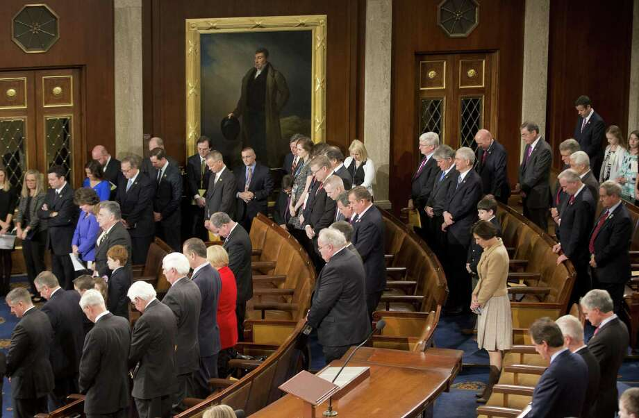 Members of the House of Representatives bow their heads during a prayer as they gather for opening session of the 114th Congress on Capitol Hill in Washington, Tuesday, Jan. 6, 2105, as Republicans assume full control. House Speaker John Boehner, R-Ohio, is expected to win a third despite a tea party-backed effort to unseat him, and Sen. Mitch McConnell, R-Ky., ascends to majority leader of the Senate after Democrats lost control the wake of November's midterm elections. (AP Photo/Pablo Martinez Monsivais ) Photo: AP / AP