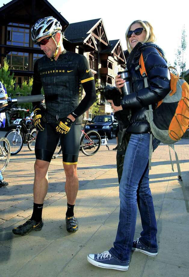 Authorities say Lance Armstrong hit two parked cars after a night of partying in Aspen but agreed to let his girlfriend take the blame to avoid national attention. Police say they cited Armstrong after the Dec. 28 hit-and-run, but only after his girlfriend, Anna Hansen, admitted to lying for him. Photo: David Zalubowski — The Associated Press File Photo   / AP