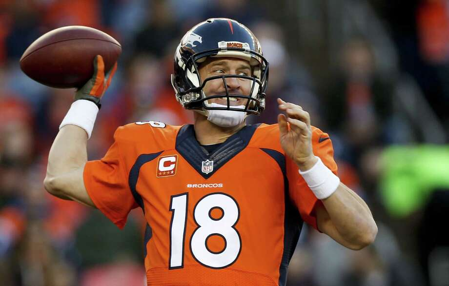 Peyton Manning will return for a fourth season in Denver and 18th in the NFL. Photo: David Zalubowski — The Associated Press File Photo   / AP