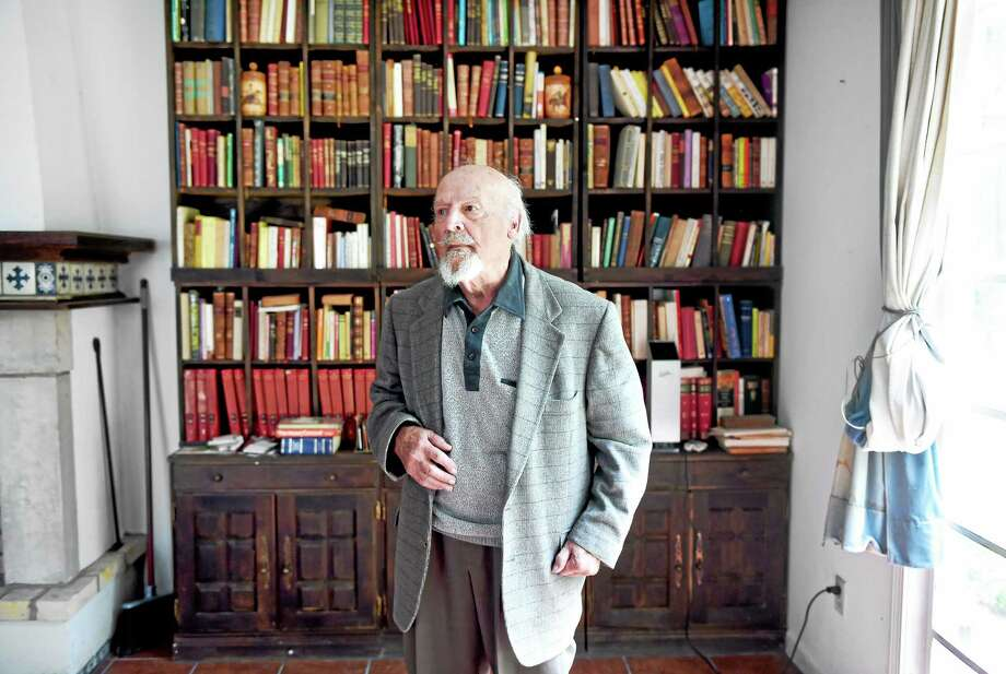 Manuel Duran, professor emeritus of Spanish and Portuguese at Yale University, in the library of his home in Orange. Photo: Arnold Gold — New Haven Register