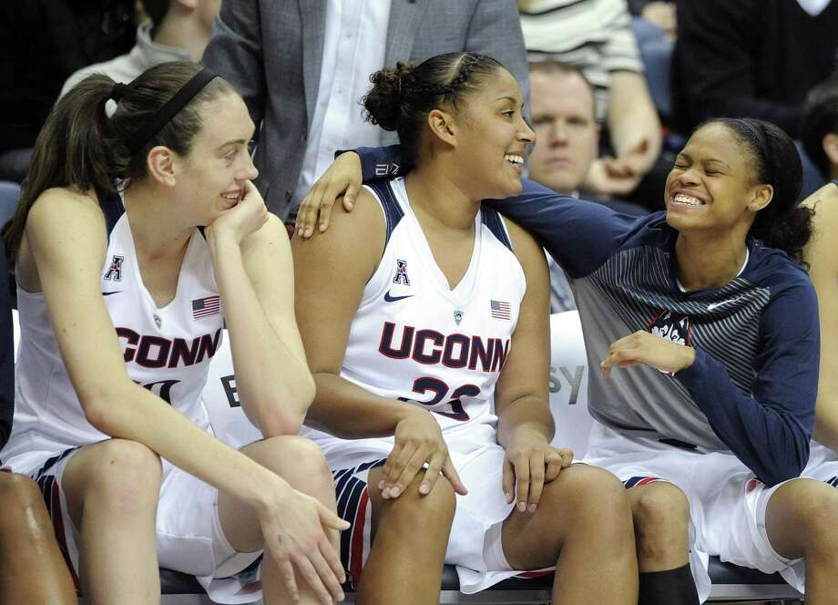 UConn's Breanna Stewart, Kaleena Mosqueda-Lewis and Moriah Jefferson, from left, react during the second half of the Huskies' 87-24 victory over Memphis in Storrs on Saturday. Photo: Fred Beckham — The Associated Press   / FR153656 AP