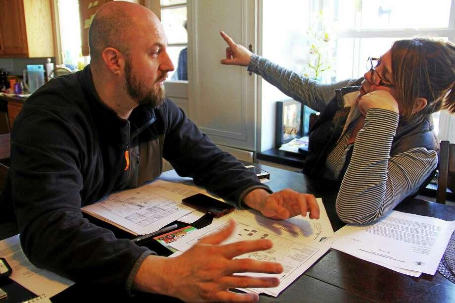 Chris Gargamelli, left, talks to his neighbor, Jeanine Santa Barbara, on Monday, April 6, during a chat at Gargamelli's house regarding the potential installation of a cell tower in Branford. Esteban L. Hernandez New Haven Register Photo: Journal Register Co.
