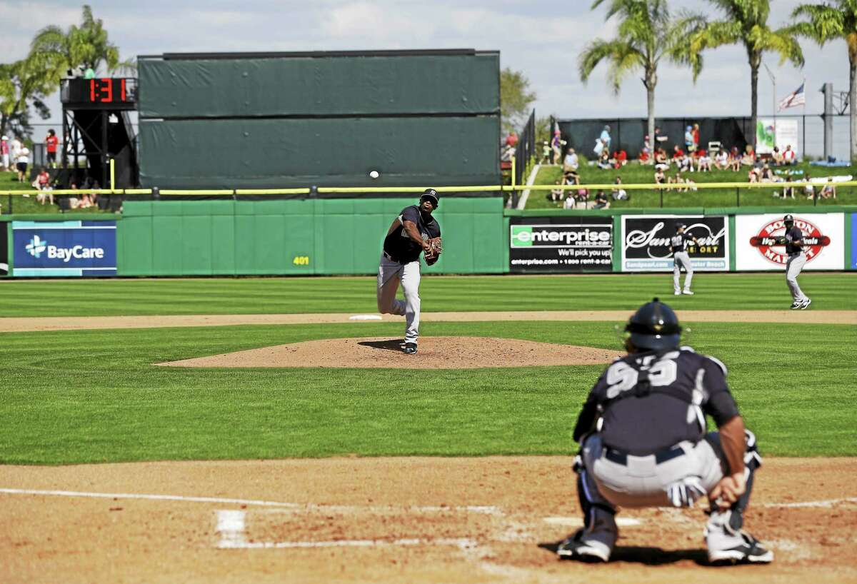 New York Yankees minor leaguer pitcher Luis Severino throws to catcher Austin Romine during a spring training game on March 3 in Clearwater, Fla.