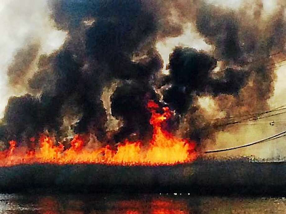 A brush fire rages in West Haven Thursday after a rail transformer reportedly exploded. Photo: Contributed Photo