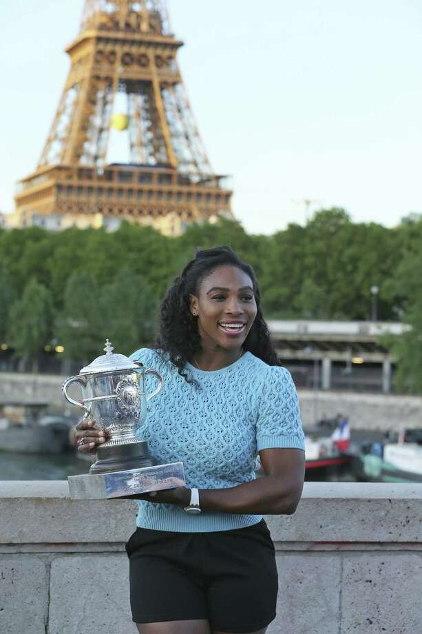 Serena Williams poses with her trophy after defeating Lucie Safarova 6-3, 6-7, 6-2 in the women's final of the French Open on Saturday at Roland Garros Stadium in Paris. Photo: David Vincent — The Associated Press   / AP