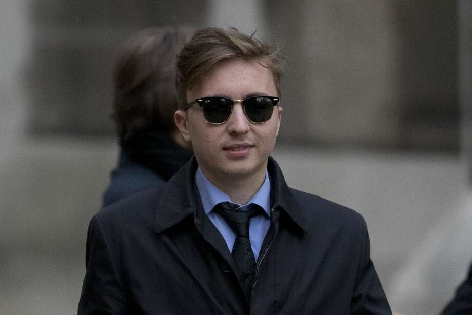 Anatoly Litvinenko, the son of former Russian intelligence officer Alexander Litvinenko, leaves after his mother Marina testified at the inquiry into her husband's death at the Royal Courts of Justice in London, Monday, Feb. 2, 2015.  The widow of former KGB officer Alexander Litvinenko described him Monday as a loyal intelligence agent who grew disillusioned with Russia's 1990s war in Chechnya and what he saw as the country's corrupted security services.  (AP Photo/Matt Dunham) Photo: AP / AP