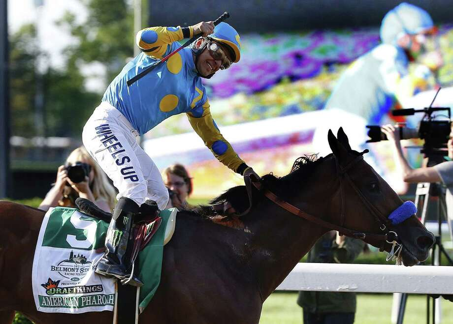 Victor Espinoza reacts after crossing the finish line with American Pharoah to win the 147th running of the Belmont Stakes on Saturday at Belmont Park in Elmont, N.Y. Photo: Kathy Willens — The Associated Press   / AP