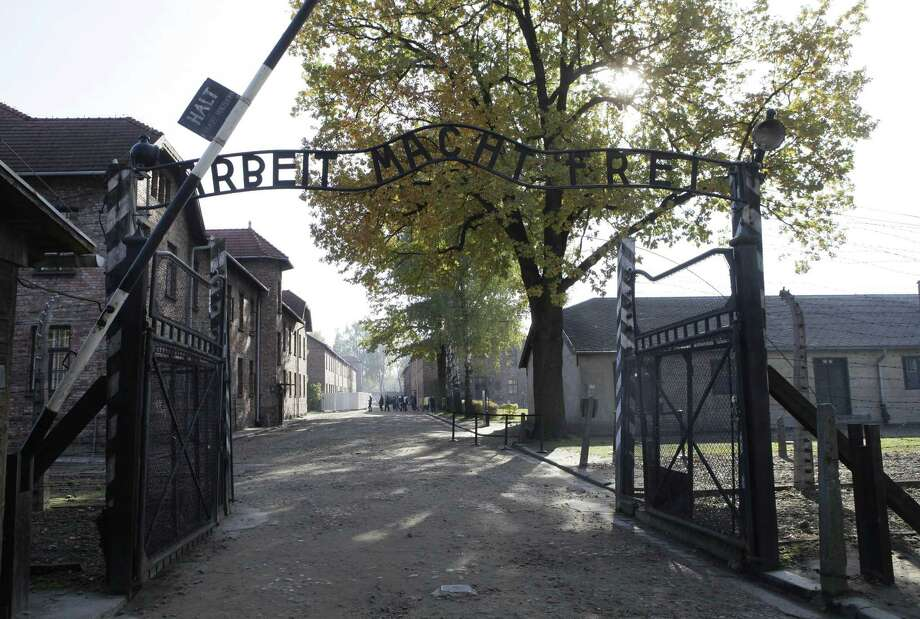 """FILE - In this Oct. 19, 2012 file photo the entrance  with the inscription """"Arbeit Macht Frei"""" (Work Sets You Free)  the former German Nazi death camp of Auschwitz is pictured in Oswiecim, Poland.   A German court says a 93-year-old man will go on trial in April on allegations he was accessory to 300,000 murders as an SS guard at the Nazisí Auschwitz death camp. The Lueneburg state court said Monday Feb. 2, 2015  Oskar Groeningís trial would open April 21. Groening has openly talked about his time as a guard and says he witnessed atrocities but didn't commit any himself. Heís one of some 30 former Auschwitz guards who federal investigators in 2013 recommended that state prosecutors pursue charges against. (AP Photo/Czarek Sokolowski, File) Photo: AP / AP"""