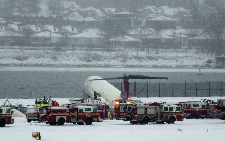 A Delta plane rests on a berm near the water at LaGuardia Airport in New York, Thursday, March, 2015. Delta Flight 1086, carrying 125 passengers and five crew members, veered off the runway at around 11:10 a.m., authorities said. Six people suffered non-life-threatening injuries, said Joe Pentangelo, a spokesman for the Port Authority of New York and New Jersey, which runs the airport. Photo: (AP Photo/Craig Ruttle) / FR61802 AP
