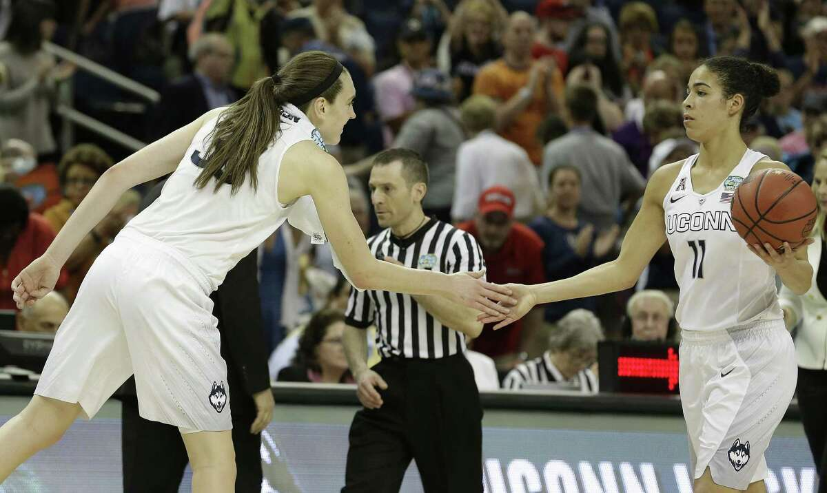 Connecticut forward Breanna Stewart (30) celebrates with Connecticut guard Kia Nurse (11) after the second half of the NCAA Women's Final Four tournament college basketball semifinal game, Sunday, April 5, 2015, in Tampa, Fla. Connecticut won 81-58. (AP Photo/John Raoux)