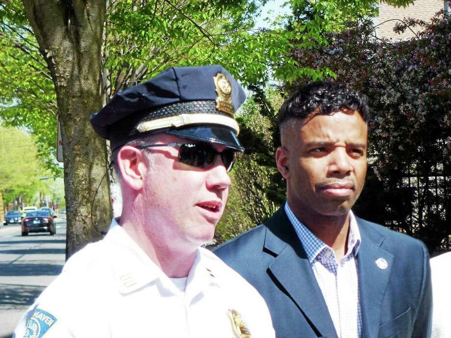 Alder Richard Furlow, D-27, and West Sector Police Capt. Jeff Hoffman talk Thursday about school bus safety. Photo: Ryan Flynn — New Haven Register