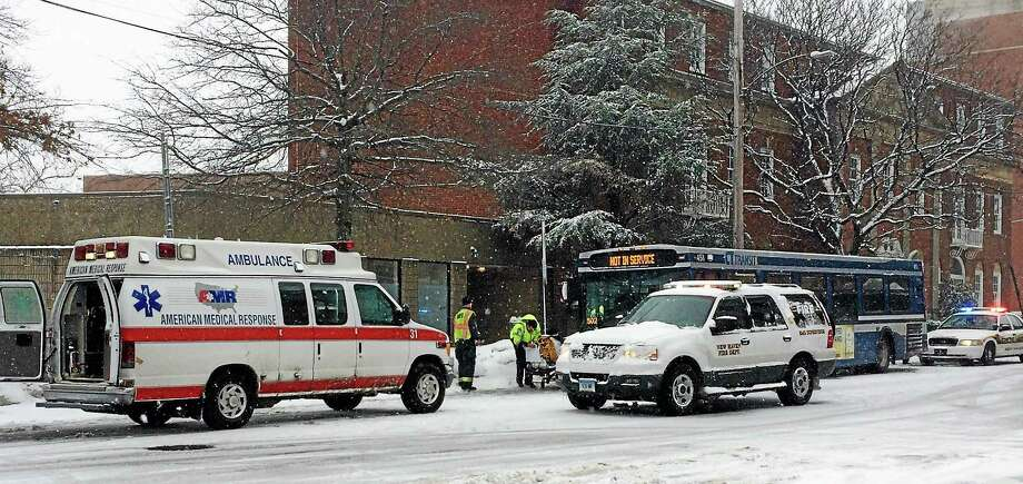 Eight people were reportedly injured Thursday when a truck collided with a bus at the intersection of College Street and Congress Avenue in New Haven. Photo: (Wes Duplantier — New Haven Register)
