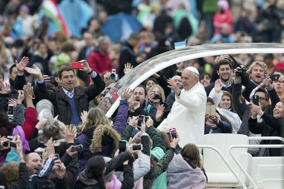 Pope Francis leaves St. Peter's square at the Vatican after he celebrated an Easter mass on Sunday, April 5, 2015. Photo: AP Photo/Andrew Medichini   / AP
