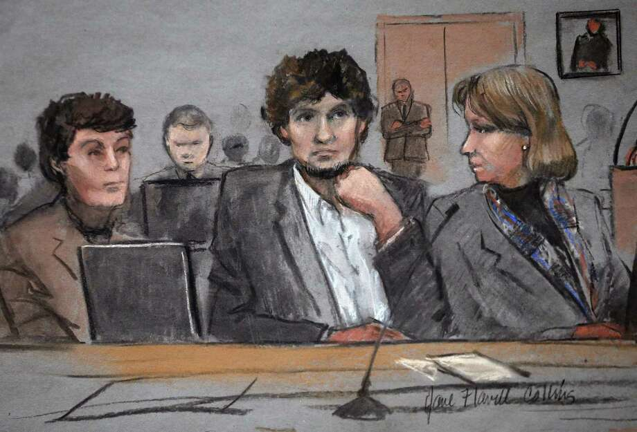 In this courtroom sketch, Dzhokhar Tsarnaev, center, is depicted between defense attorneys Miriam Conrad, left, and Judy Clarke, right, during his federal death penalty trial, Thursday, March 5, 2015, in Boston. Tsarnaev is charged with conspiring with his brother to place two bombs near the Boston Marathon finish line in April 2013, killing three and injuring 260 people. (AP Photo/Jane Flavell Collins) Photo: AP / Jane Flavell Collins