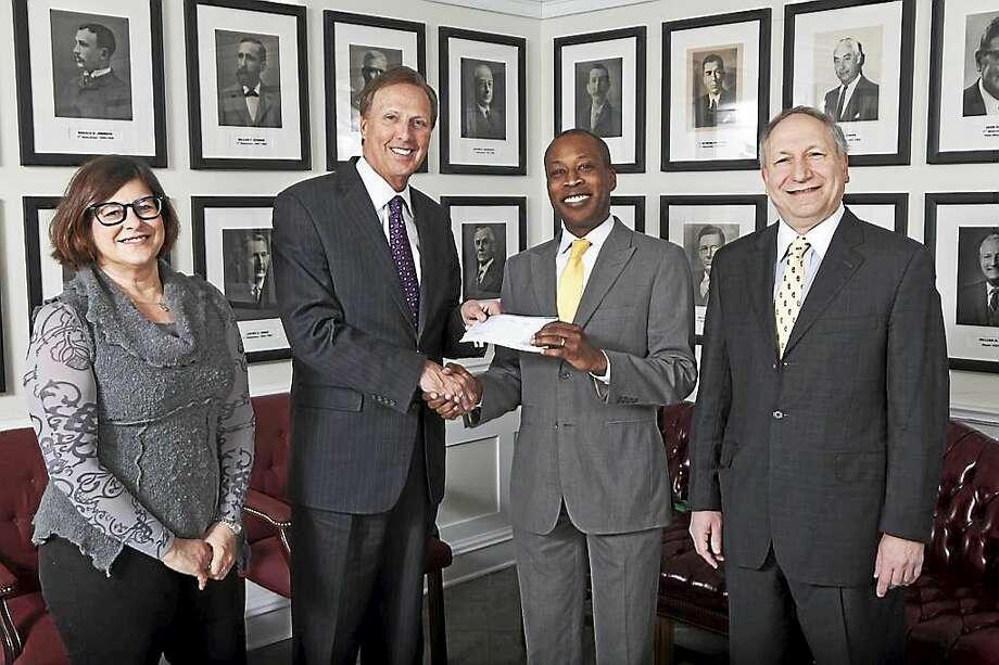Quinnipiac University President John L. Lahey presents a voluntary payment of $1.2 million to Hamden Mayor Scott Jackson. Photo: Contributed Photo