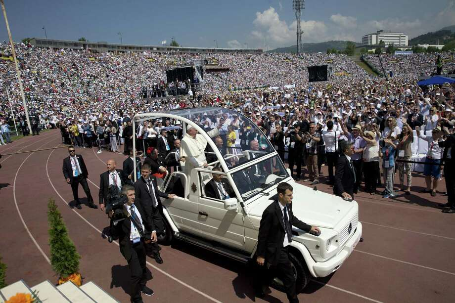 "Pope Francis arrives to celebrate a Mass at the Kosevo stadium, in Sarajevo, Bosnia-Herzegovina, Saturday, June 6, 2015. Pope Francis urged Bosnia's Muslims, Orthodox and Catholics to put the ""deep wounds"" of their past behind them and work together for a peaceful future as he arrived in Sarajevo on Saturday for a one-day visit to encourage reconciliation following the devastating three-way war of the 1990s. (AP Photo/Andrew Medichini) Photo: AP / AP"