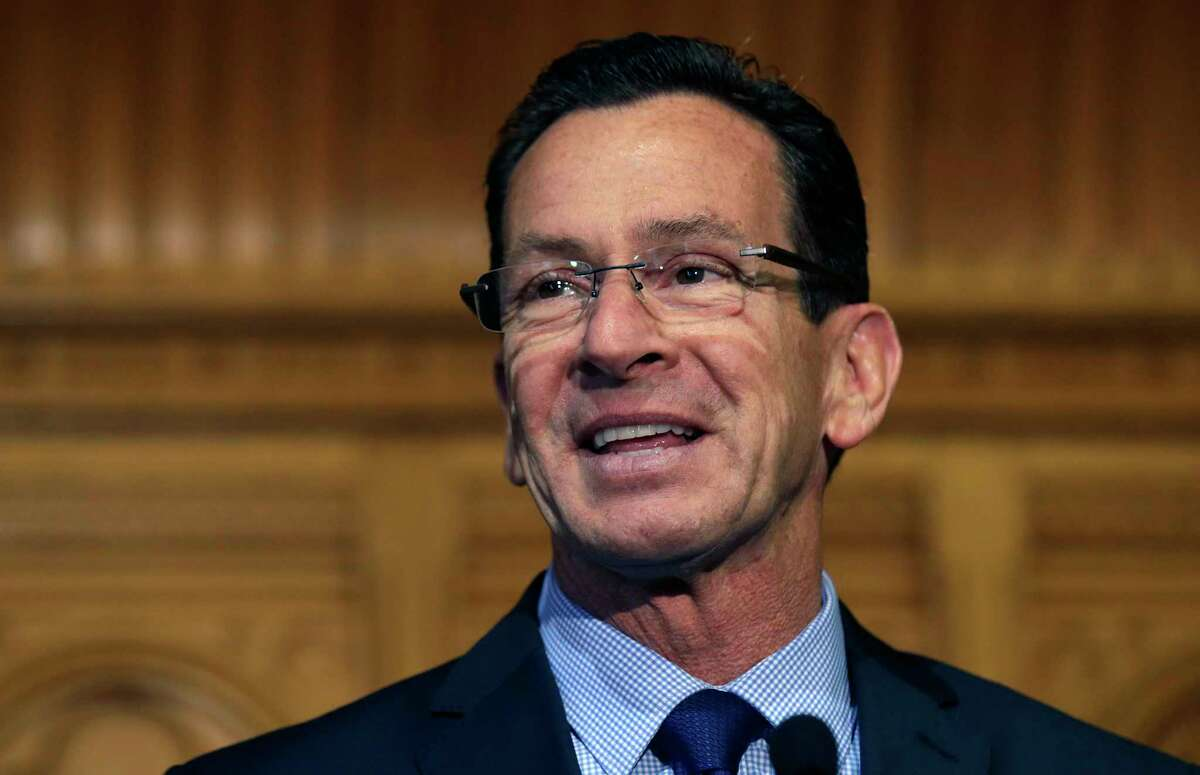 In this Nov. 5, 2014 photo, Connecticut Gov. Dannel Malloy smiles as he thanks supporters at the State House in Hartford.