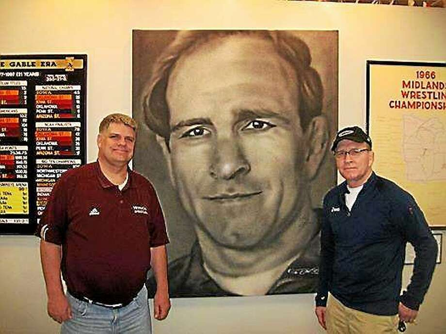 Submitted  Scott Schulte, who grew up in Milford, at left, along with Iowa wrestling coaching legend Dan Gable at a recent book signing. Photo: Journal Register Co.