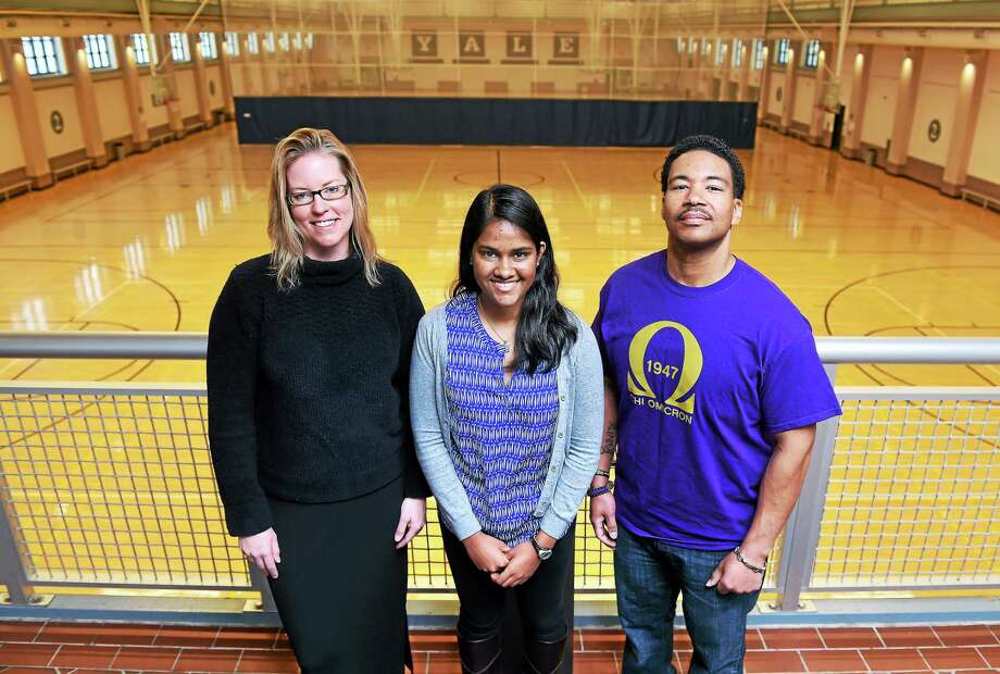 Left to right, Erika Ganley, Community Manager for the American Cancer Society's Relay for Life, Samantha Nanayakkara, student co-chairman of the planning committee, and participant Aurelious Woolfolk, Jr., of the Chi Omicron Chapter of Omega Psi Phi Fraternity are photographed at the Lanman Center at Yale University on 3/30/2015. Photo: (Arnold Gold-New Haven Register)