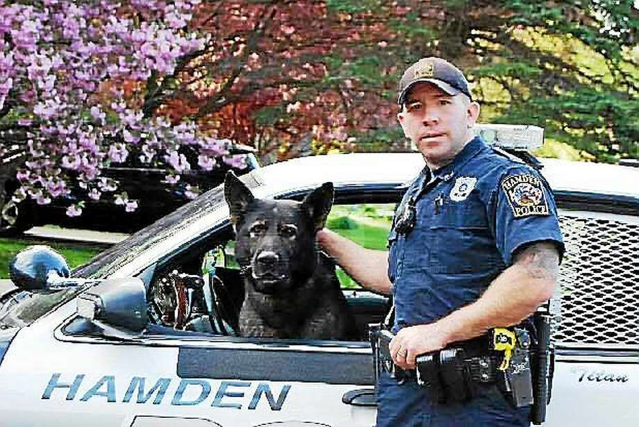Titan with his handler, Sgt. Jason Venditto. Titan served the department for more than 10 years before retiring in 2013. He died Dec. 30. Photo: (Photo Courtesy Of The Hamden Police Department)