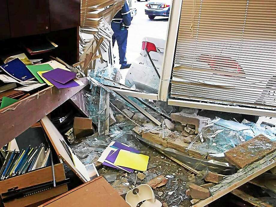 A Wells Fargo bank branch in Orange was extensively damaged after a car crashed into it Saturday. Police said the elderly driver accidentally pressed the gas pedal instead of the brake while backing out of a parking space. Photo: (Photo Courtesy Of The Orange Police Department)