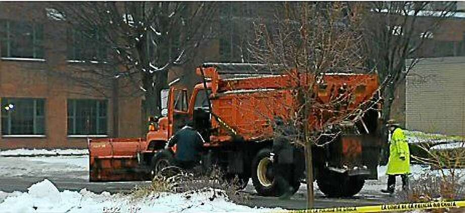 Torrington police are investigating after a man was fatally struck by a city plow truck while jogging Sunday morning. (Photo via screenshot from WTNH.com) Photo: Journal Register Co.