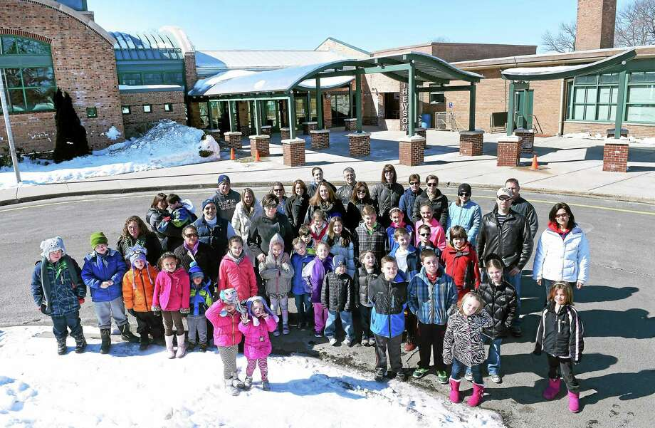 Children and their parents are photographed in front of Mathewson School in Milford recently. Photo: Arnold Gold — New Haven Register