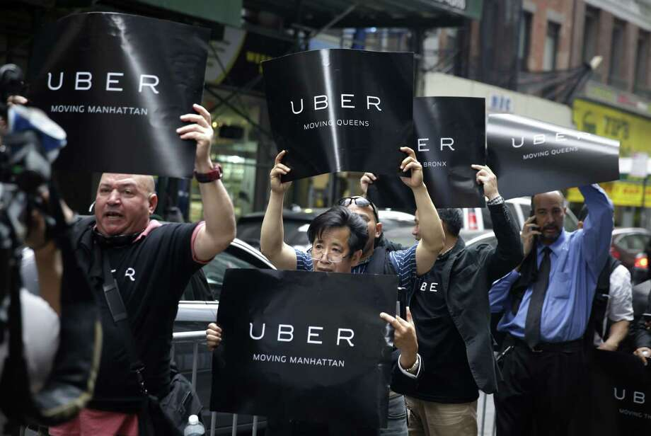 Uber drivers and their supporters protest in front of the offices of the Taxi and Limousine Commission in New York. Photo: Seth Wenig — The Associated Press   / AP