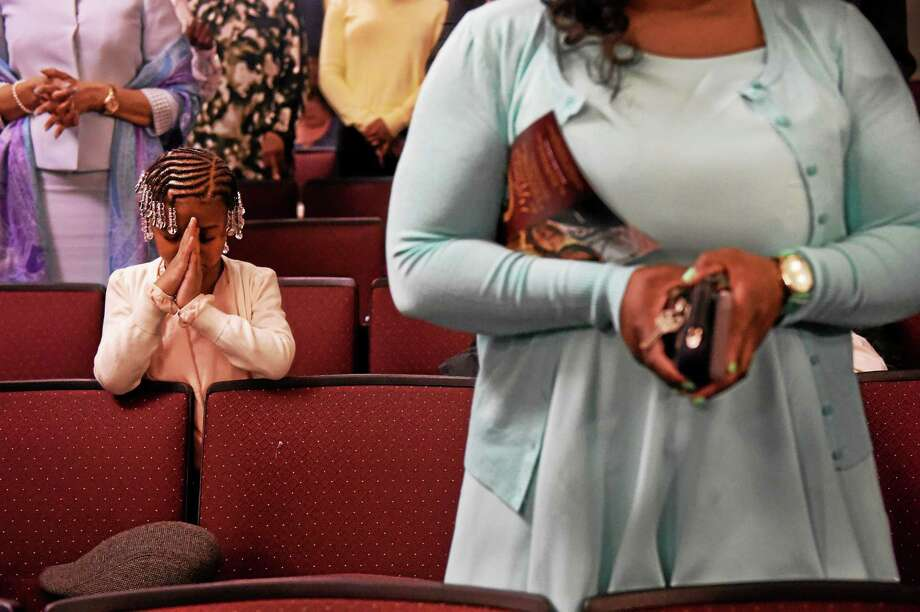 "Arihana Alston of New Haven, 5, bows her head in prayer during Varick Memorial A.M.E. Zion Church's  Easter Sunday worship service, ""Resurrection Sunday"" at the Wilbur Cross High School Auditorium Sunday morning. Photo: (Peter Hvizdak - New Haven Register)   / ©2015 Peter Hvizdak"