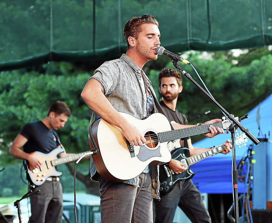 File photo: The band, 'Beach Avenue,' led by Nick Fradiani, rocks the crowd at the Hamden Town Center Park as they open up for Fran Cosmo, former lead singer of 'Boston.' Photo: (Peter Casolino-New Haven Register)