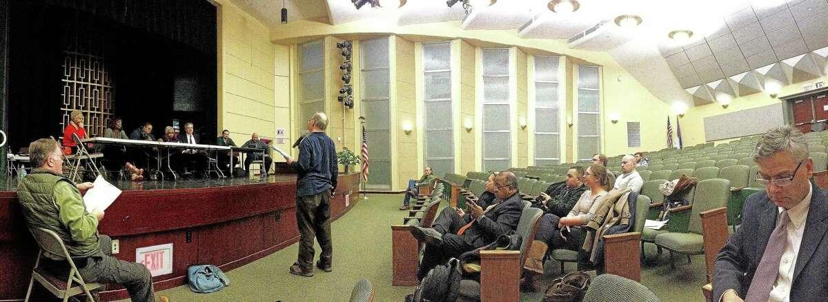 New Haven resident Art Perlo speaks at Thursday's night's open budget hearing.