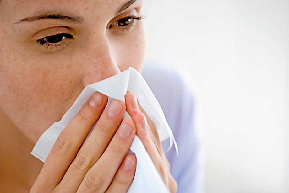 Woman blowing nose Photo: Getty Images/Pixland / Pixland