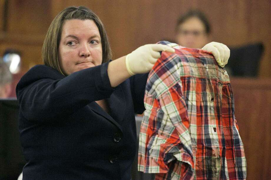 Massachusetts State Police chemist Sherri Melendez holds up a shirt recovered from the body of Odin Lloyd as she testifies during Aaron Hernandez's murder trial Wednesday at Bristol County Superior Court in Fall River, Mass. Photo: Dominick Reuter — The Associated Press   / Pool EPA