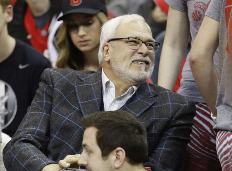 New York Knicks president Phil Jackson is seen before the start of a college basketball game between Ohio State and Nebraska last Thursday in Columbus, Ohio. Photo: Paul Vernon — The Associated Press   / FR66830 AP