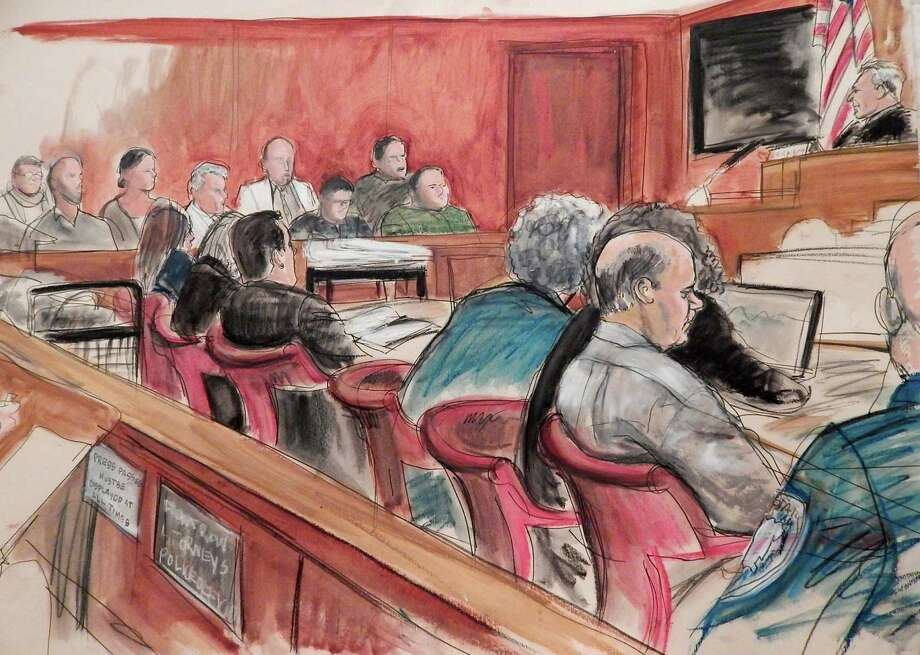 In this April 27, 2015 courtroom sketch, defendant Pedro Hernandez, in profile at right, sits at a table with his defense team as Judge Maxwell Wiley, upper right, addresses the jury, in background, in Manhattan state Supreme Court, where Hernandez is on trial in New York in the case of missing first-grader Etan Patz who disappeared four decades ago on his way to school. Fifteen days into their deliberations, jurors have twice said they can't reach a unanimous verdict and have been told to keep trying. They are weighing murder and kidnapping charges against Hernandez, 54, who confessed three years ago to killing 6-year-old Etan in 1979; his lawyers say his confession was imaginary and another suspect is the more likely killer. Harvey Fishbein, lead  defense attorney, is in blue suit at center of table. (AP Photo/Elizabeth Williams) Photo: AP / FRE142054