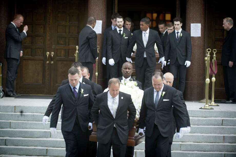 Hundreds mourn and attend the funeral for the Savopoulos Family  at the Saint Sophia Orthodox Greek Cathedral in Washington, DC, on Monday, June 01, 2015. Savvas, Amy and their son Philip were taken hostage and murdered during a robbery at their home. Photo: (Marvin Joseph/The Washington Post Via AP)   / The Washington Post